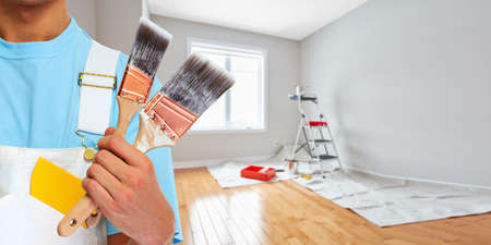 Professional man painter hand with brush. House renovation