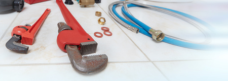 Plumbing pipe wrench background.