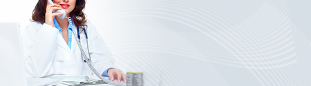 Medical doctor woman working in clinic. Health care backgroun Stock Photo