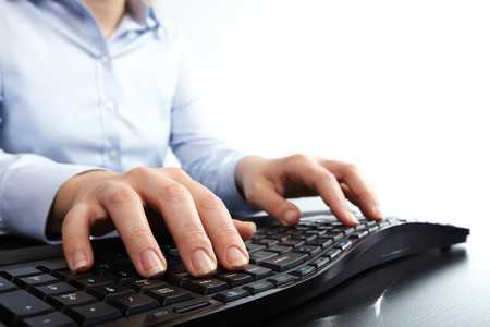 Hands typing keyboard. Stock Photo