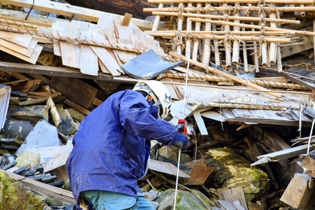 Restoration worker in the collapse site Stock Photo