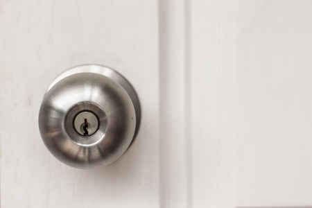 door: a handle on a door that is turned to release the latch Stock Photo