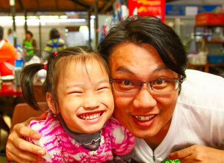 daugther: father and daugther smile