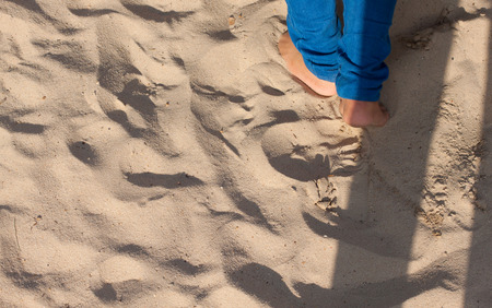 adult footprint: sand and foots Stock Photo