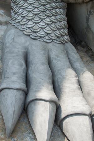 ripped metal: hand dragon Stock Photo