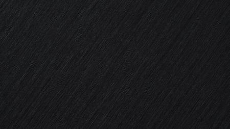 Black abstract metallic background, pattern of brushed metal texture Standard-Bild