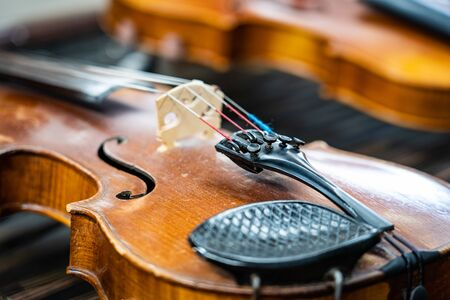 Antique violin and violin bow lying on dulcimer. Close up a violin instrument and cymbal before a concert. Music concept background