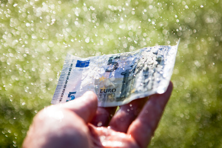 rain wet: Money laundering Stock Photo