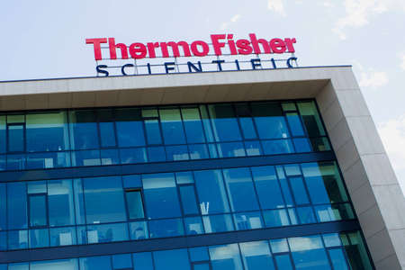 spectrometry: Vilnius, Lithuania - August 6 2015: the logo of the brand Thermo Fisher Scientific Inc. NYSE: TMO the world leader in serving science, with revenues of 17 billion and approximately 50,000 employees