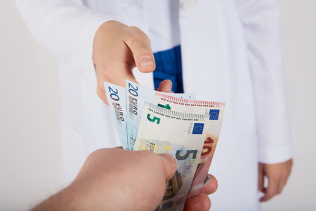 doctor money: Doctor takes money from patient, white background
