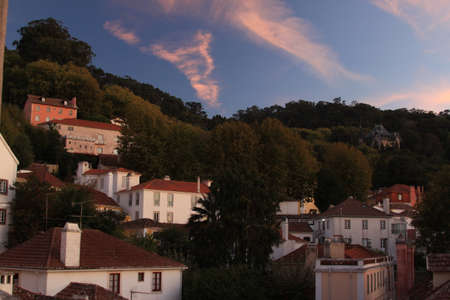 Sunset in Sintra in Portugal. Blue sky with pink clouds and roofs of houses in old city Sintra,
