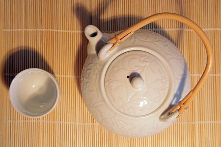 teaset: White teaset on a bamboo mat Stock Photo