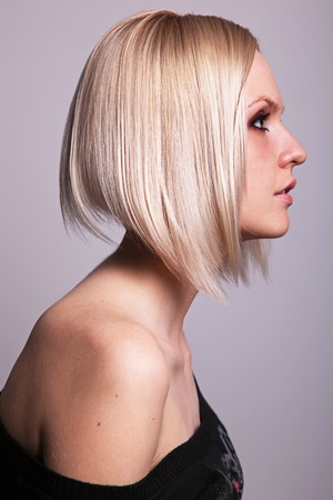 haircut: Pretty young blond girl in profile