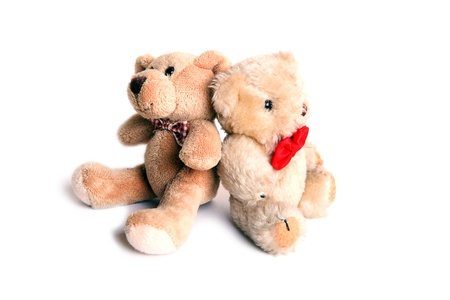 Two tiny toy bears with bow ties, isolated photo