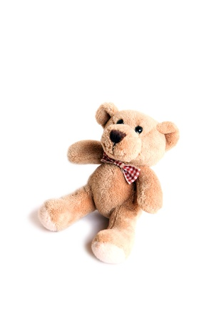 Tiny toy bear with a bow, isolated photo