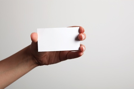 A hand holding a blank white card Stock Photo - 11159895