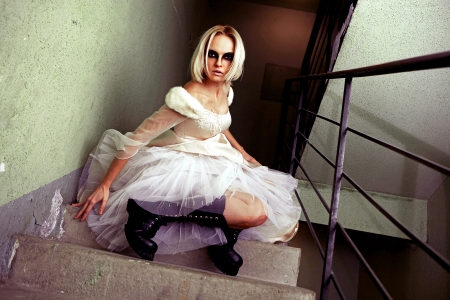A stylized picture of a young blond girl dressed up like a  gothic  bride  photo