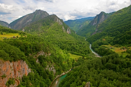 tara: A beautiful view of the Canyon of the Tara river with a settlement at the bottom  Montenegro  Stock Photo