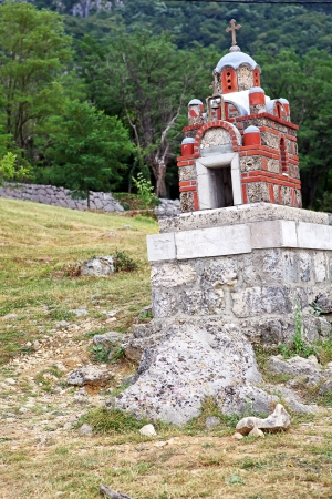 lopsided: A tiny chapel on the lopsided pedestal  Taken near the monastery of Ostrog, Montenegro  Stock Photo