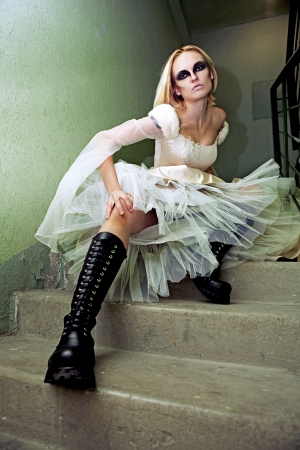 Beautiful young blond girl dressed like gothic bride. photo