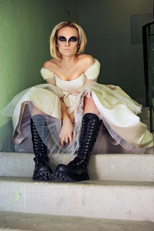 Beautiful young blond girl dressed like a gothic bride. photo