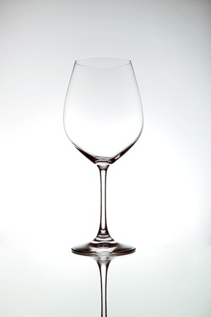 An elegant wine glass with a reflection