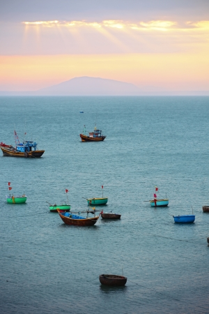 View of the sunset in the Vietnamese fishing village. photo