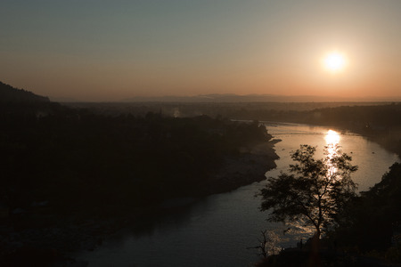 murk: Sunset over The Ganges in Rishikesh, India. Stock Photo