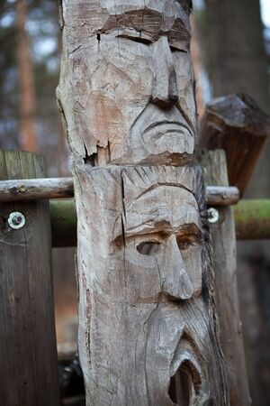 An old handmade wooden idol of slavic god in the forest Stock fotó