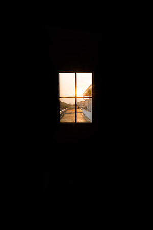windows frame: looking through the window during sunset