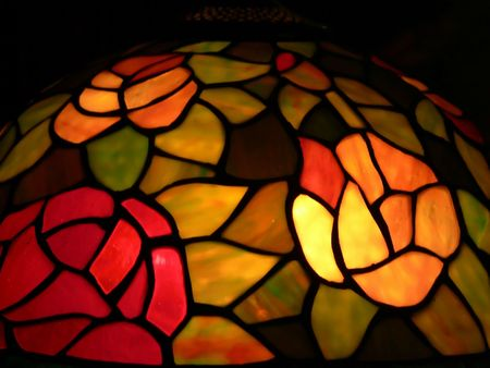 A tiffany looking lamp shade with colorful rose pattern.  50145