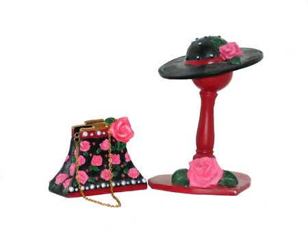 A miniatur hat and purse fron a collection over white background.   50992 Stock Photo - 797068
