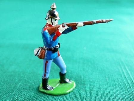 A single led toy soldier from late 1800 on green background.    30646