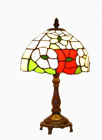 An tiffany lamp with wood stand on white background.  50971 Archivio Fotografico