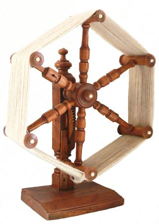 winder: Yarn winder  50311. An antique yarn winder with wool on after spinning. Used in the textile