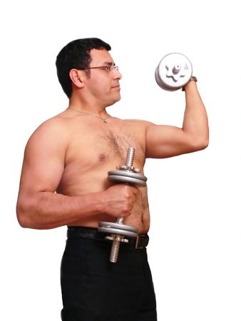 Exercise   60472. An muscles man is exercising with his dumbbells to stay in shape.