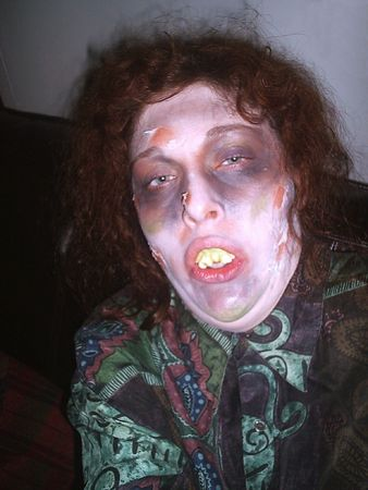 horrify: Halloween  11610 An girl with an Halloween make-up looking like a zombie.      Stock Photo