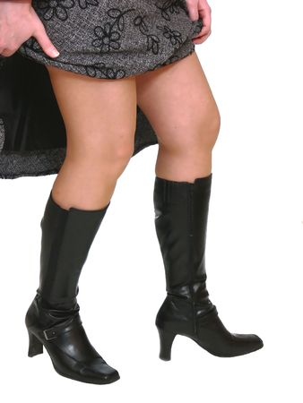 nice legs: Nice legs  60442. An young woman lifting up her skirt and showing her nice legs and her new boots. Stock Photo