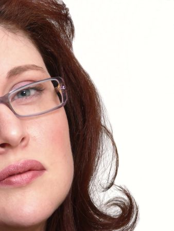 half face: Beautiful woman  60395.A half face portrait of a beautiful woman with long red hair and glasses.