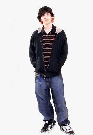 Teen boy  60774 A teenage boy is standing in the studio in his jeans and sneakers with his hands in the pocket, on white background.   Stock Photo