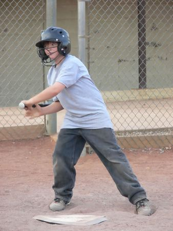 A young baseball player in training on late afternoon with his team. photo