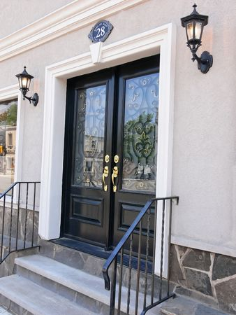 sidelight: A beautiful new and decorative entrance door an the main street ofStoney Creek Ontario.