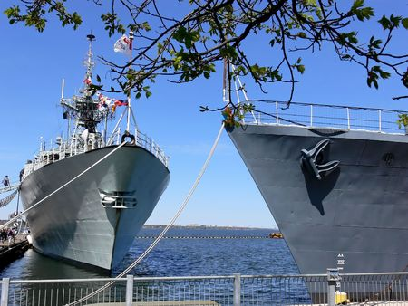 warship: Two warships. The warship Halifax, left, and the WW II warship HMCS Haida in the Hamilton harbor. Stock Photo