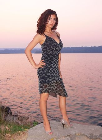 evening glow: Pretty girl on the lake Stock Photo