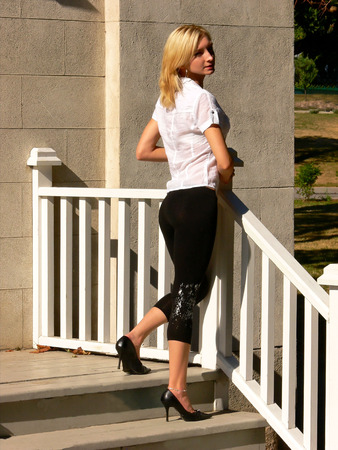 nice butt: Lady on the handrail. Stock Photo