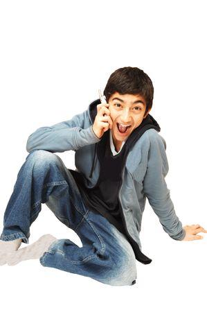 Teen boy on the phone. photo