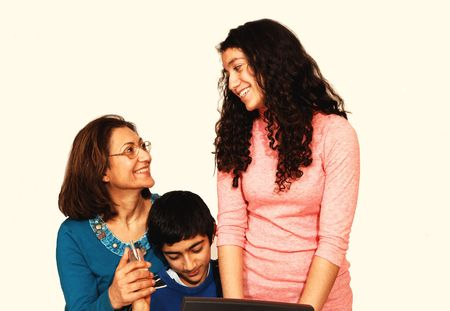 A mother with daughter and son sitting on the floor and having a very photo