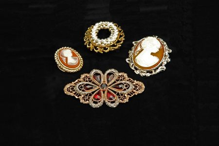 cameo: Very old 2 brooches and 2 cameo on black background.