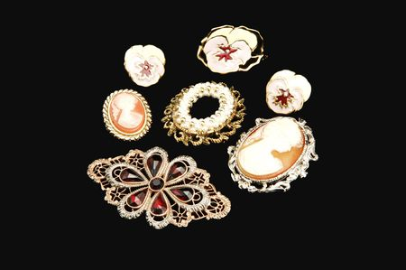 An assortment of old antique jewelries on black background.