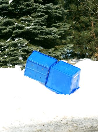 disuse: Empty recycling boxes in snow. Stock Photo